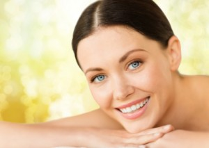 beautiful smiling woman in spa salon