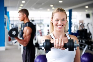 Young Adults Lifting Weights at the Gym