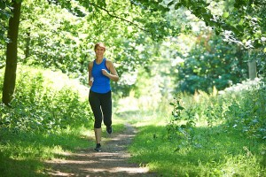 Middle Aged Woman Running In Countryside
